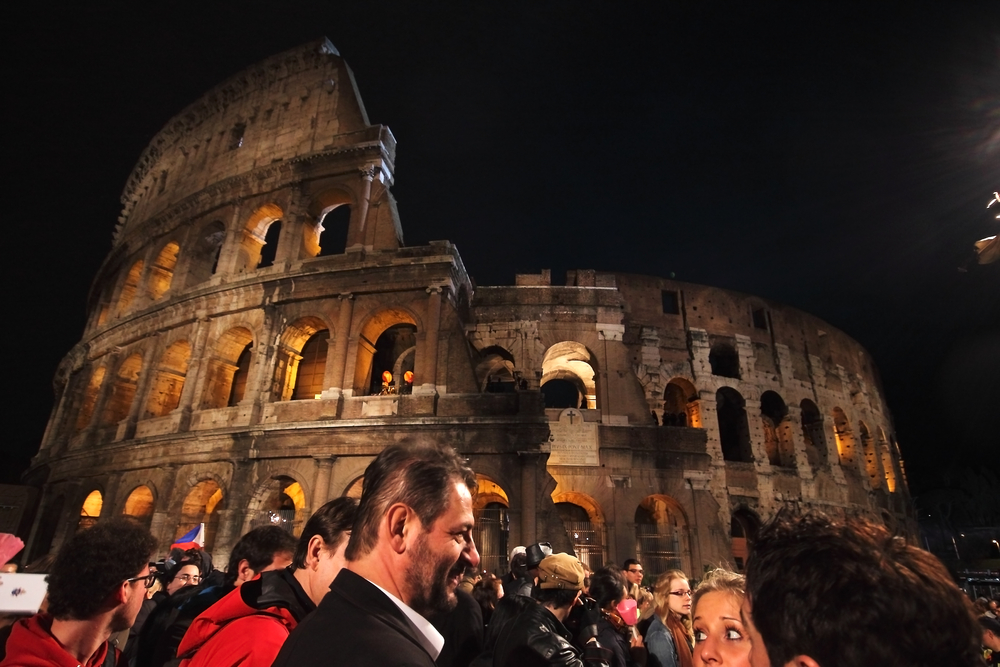 People wait for the Stations of the Cross chaired by the Pope Francis I around the Colosseum on Good Friday